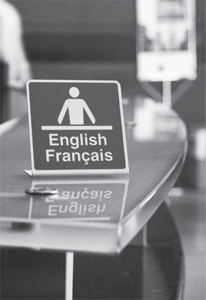 Sign indicating that service is provided in both official languages