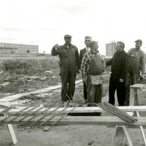During the construction of the Arts building (around 1963). From left to right, Eric LeBlanc, Abbaey Landry, Père Clément Cormier, Camille LeBlanc.